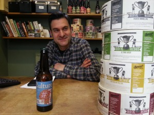 Andrew with a bottle of Culture #1 and labels ready for Record Store Day.